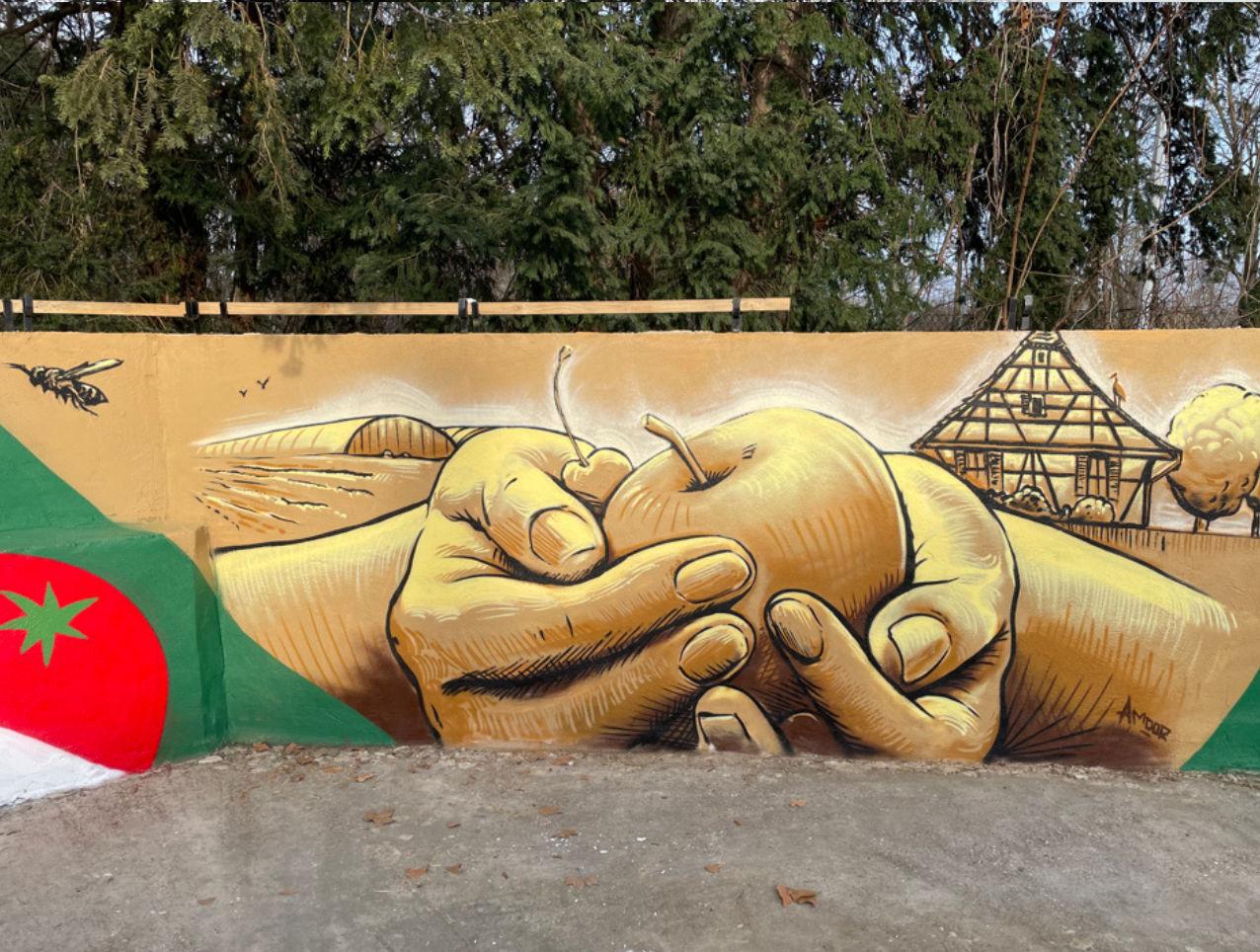 Fresque mains et fruits peinture art urbain graffiti street art